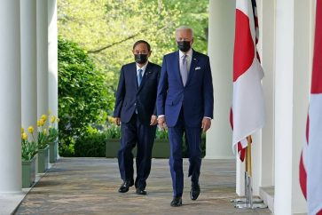 US President Joe Biden and Japan's Prime Minister Yoshihide Suga walk through the Colonnade to take part in a joint press conference in the Rose Garden of the White House in Washington, DC on April 16, 2021. (Photo by MANDEL NGAN / AFP)